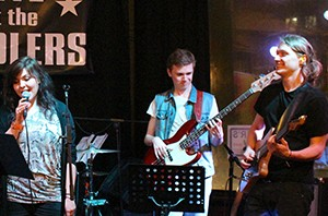 singer, bassist and electric guitar players