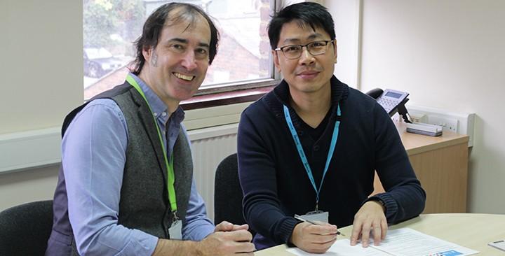 Pete Whittard and Setiawan Winarto signing a partnership