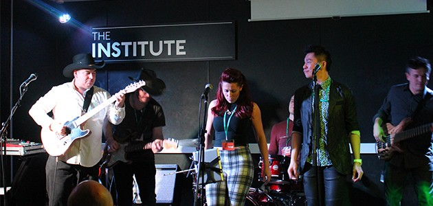 Tutors playing music at the Institute