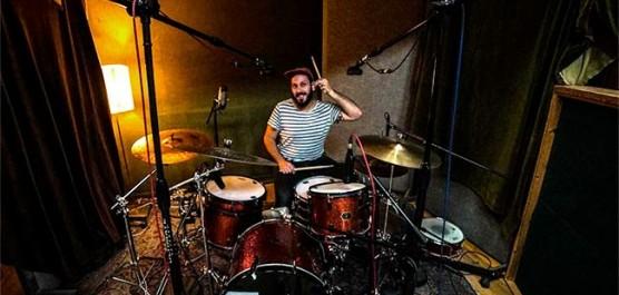 PJ at drumkit • Reviewing microphones